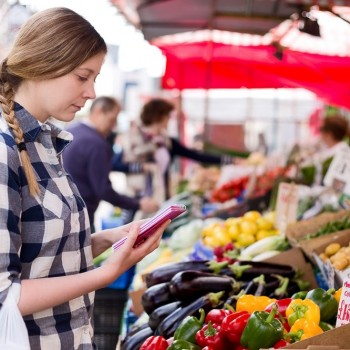 A girl selects food at a market that are good for her teeth